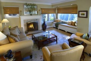 Traditional Living Room with Window seat, Standard height, can lights, Casement, Fireplace, stone fireplace, Crown molding