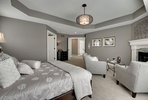 Contemporary Master Bedroom with Cement fireplace, Jonathan adler duvet cover, flush light, Carpet, Built-in bookshelf