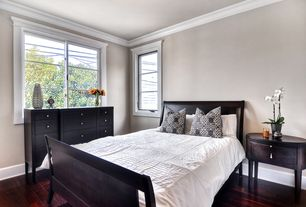 Traditional Guest Bedroom with Hardwood floors, Port 12-Drawer High Dresser, High ceiling, Crown molding