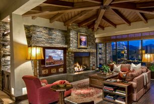 Rustic Living Room with Columns, TayseRugs Capri Red Oriental Area Rug, Exposed beam, Daltile Tibetan Slate Stacked Stone