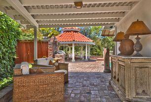 Mediterranean Porch with Gazebo, exterior brick floors, Fence, Raised beds, Outdoor kitchen