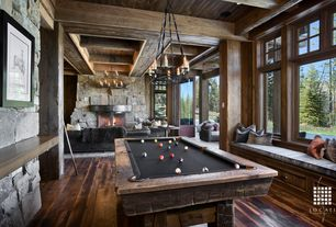 Rustic Game Room with Rough stone wall, Cabot rectangular chandelier, Window seat, Reclaimed timber pool table