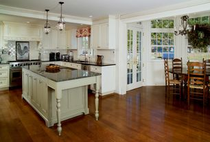 Traditional Kitchen with Simple granite counters, Crown molding, L-shaped, Undermount sink, Soapstone counters, Pendant light