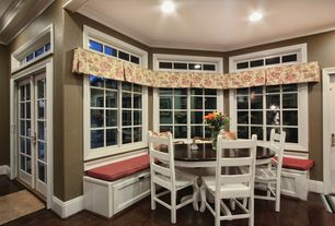 Traditional Dining Room with Window seat, Hardwood floors, Crown molding
