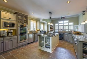 Traditional Kitchen with Raised panel, Limestone Tile, Crown molding, Restoration hardware industrial pulley single pendant