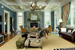 Eclectic Living Room with Chandelier, stone fireplace, Crown molding, Hardwood floors, French doors, Box ceiling