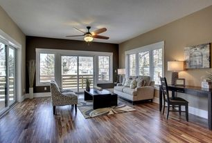 Traditional Living Room with Standard height, Ceiling fan, double-hung window, Hardwood floors, sliding glass door