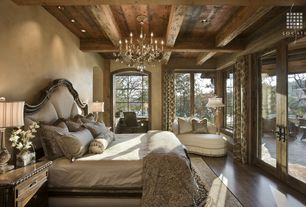 Country Master Bedroom with Casement, Exposed beam, Standard height, Chandelier, can lights, Window seat, Laminate floors