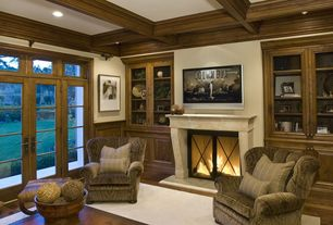 Traditional Living Room with Transom window, Metal fireplace screen, Display case, Upholstered armchair, Crown molding
