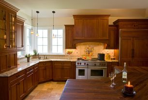 Traditional Kitchen with Glass panel, Kitchen island, Pendant light, Wood counters, slate tile floors, Raised panel, L-shaped