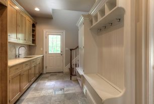 Traditional Mud Room with travertine floors, Standard height, can lights, Glass panel door, Built-in bookshelf