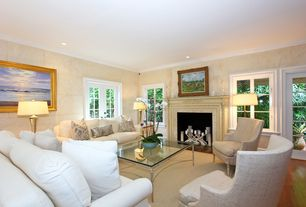 Traditional Living Room with Fireplace, Casement, French doors, stone fireplace, Hardwood floors, Crown molding, can lights