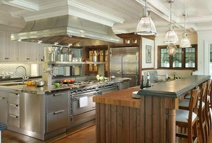 Traditional Kitchen with Island Hood, Kitchen island, Stainless steel counters, Farmhouse sink, Soapstone counters, Casement