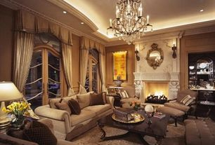 Traditional Living Room with Standard height, other fireplace, French doors, Carpet, Fireplace, Chandelier, Crown molding
