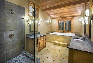 Rustic Master Bathroom with Slate counters, Arizona tile, BURGUNDY SERIES, Ceramic, Exposed beam, Wall sconce, Raised panel