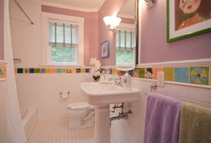 Traditional Kids Bathroom with Crown molding, Wall sconce, Pedestal sink, penny tile floors, tiled wall showerbath