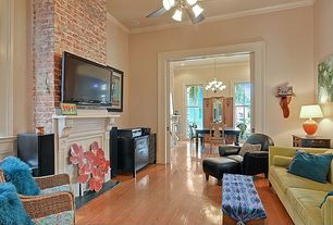 Contemporary Living Room with Crown molding, Hardwood floors, Ceiling fan, stone fireplace