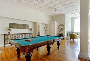 Eclectic Game Room with High ceiling, Ceiling fan, Built-in bookshelf, Box ceiling, Hardwood floors