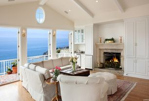 Traditional Living Room with Hardwood floors, paint2, Exposed beam, MS International Jania Cream Limestone, Wall sconce