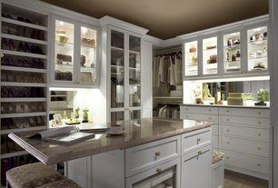 Traditional Closet with Built-in bookshelf, Oregon tile & marble oyster beige marble, Ayala sculpture, Hardwood floors