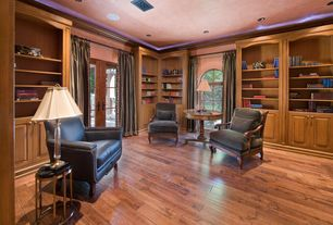 Traditional Home Office with French doors, Built-in bookshelf, Hardwood floors, Crown molding, Arched window