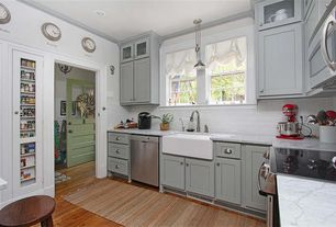 Cottage Kitchen with Built-in bookshelf, Glass panel, Hardwood floors, Complex marble counters, Pendant light, Farmhouse sink