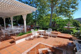 Traditional Patio with exterior tile floors, Fence, exterior terracotta tile floors, Trellis, Fountain