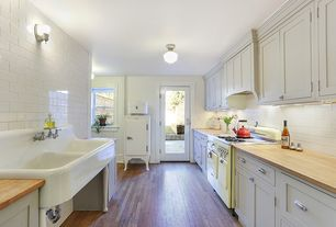 Country Kitchen with Subway Tile, Wood countertop, French doors, Classic schoolhouse pendant, Wood counters, Wall sconce