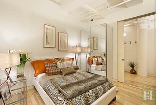 Contemporary Guest Bedroom with specialty door, Hardwood floors