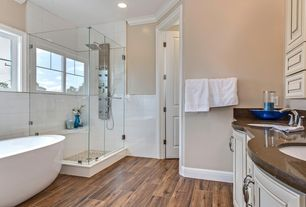 Contemporary Master Bathroom with Hampton Bay High Gloss Natural Palm Laminate Flooring, Flat panel cabinets, Crown molding
