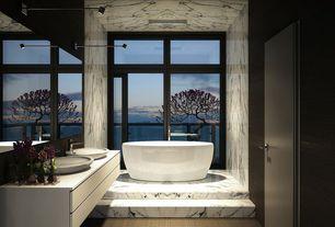 Contemporary Master Bathroom with Double sink, Balcony, Hardwood floors, European Cabinets, Vessel sink, Flush, Freestanding