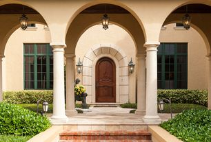 Mediterranean Front Door with exterior tile floors
