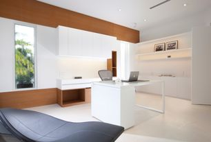 Contemporary Home Office with limestone floors, High ceiling, Built-in bookshelf