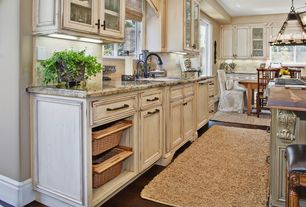 Country Kitchen with High ceiling, Wood counters, Surya Mellow Parchment Rug, Dura Supreme Cabinetry Sophia, Limestone Tile