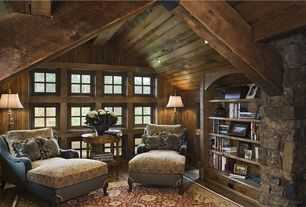 Traditional Library with Wood paneled walls, Exposed beam, Cathedral ceiling, Built-in bookshelf, can lights, picture window