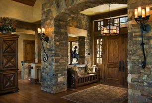 Entryway with Chandelier, Hardwood floors, Standard height, Transom window, French doors, Wall sconce, can lights