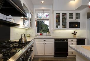 Traditional Kitchen with Simple granite counters, White subway tile, built-in microwave, double-hung window, Glass panel