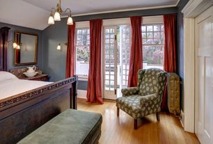Traditional Guest Bedroom with French doors, Crown molding, double-hung window, Hardwood floors, Chandelier, Wall sconce