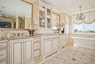 Country Master Bathroom with Inset cabinets, Shower, Chandelier, Undermount sink, Built-in bookshelf, can lights, Bathtub