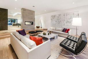 Modern Living Room with Regency Princeton Leather Lounge Chair, Hardwood floors, Regency Princeton Leather Ottoman, Columns