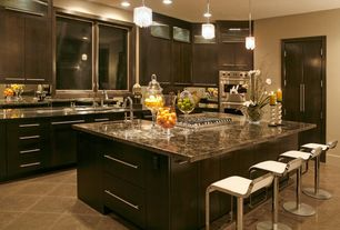 Contemporary Kitchen with Soapstone counters, Ms International Juparana Persa Granite, Glass panel, Standard height, Flush