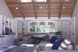 Contemporary Great Room with Exposed beam, double-hung window, Skylight, Chandelier, Carpet, six panel door, Pendant light