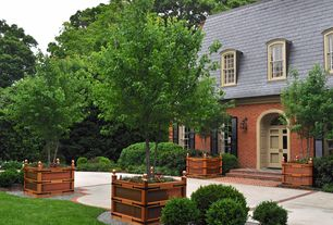 Traditional Landscape/Yard with double-hung window, Pathway, Transom window, Arched window, exterior stone floors
