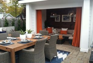 Contemporary Patio with exterior stone floors, Fence