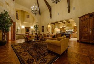 Mediterranean Living Room with Sandstone tile walls, Open concept, Hardwood floors, Open archway, High ceiling, Oriental rug