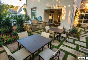 Traditional Patio with Outdoor kitchen, exterior stone floors, Fence, French doors