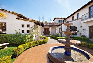 Mediterranean Landscape/Yard with Fountain, exterior terracotta tile floors, Bird bath, French doors, Pathway, Arched window
