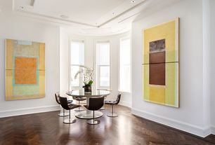 Contemporary Dining Room with Hardwood floors, Standard height, can lights, double-hung window