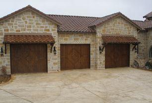 Mediterranean Garage with Concrete floors, specialty door