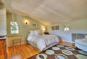 Cottage Guest Bedroom with Built-in bookshelf, Standard height, Hardwood floors, Wall sconce, Casement, double-hung window